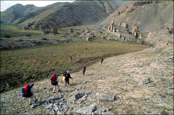 Hikers approach limestone columns, Sadlerochit Mountains